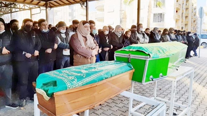 Yanarak ölen iki kardeş yan yan defnedildi